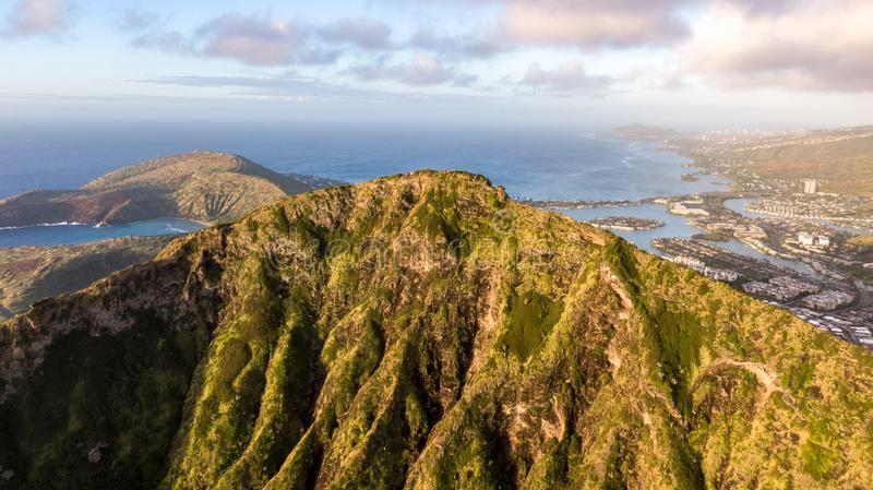 Aerial drone sunrise view of Koko Head Koko Crater mountain, an ancient volcanic tuff crater with its summit 368 m elevation,. Hawaii Kai in the background. A royalty free stock image