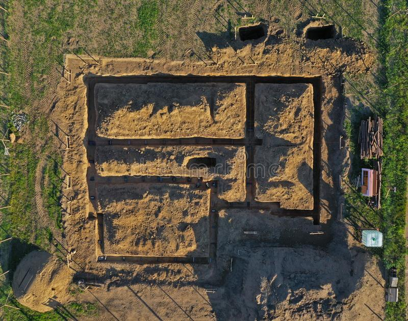 Aerial drone top down view on construction site with excavated hummus ground prepared for house foundation concrete pouring royalty free stock photography