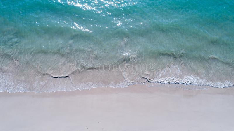 Aerial top view of empty sandy beach and sea stock photography