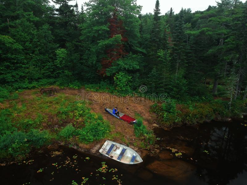 Aerial Drone view of an Adirondack Canoe and rowboat at sunset in the mountain wilderness. Aerial Drone view of a Canoe and rowboat at sunset in the Adirondack stock images