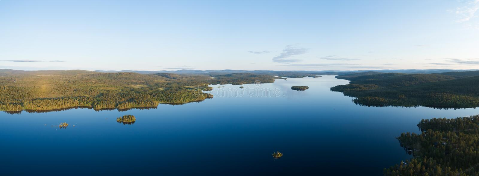 Aerial drone view of beautiful blue lake Inari and green forest. Beautiful summer panorama. Inarijarvi,Lapland stock photography
