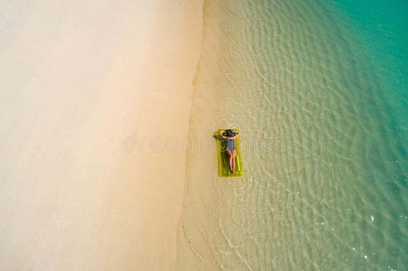 Aerial drone aerial view of Beautiful girl having fun on the sunny tropical beach. Seychelles royalty free stock images