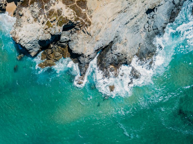 Aerial Drone View Of Dramatic Ocean Waves Crushing On Rocky Shore stock images