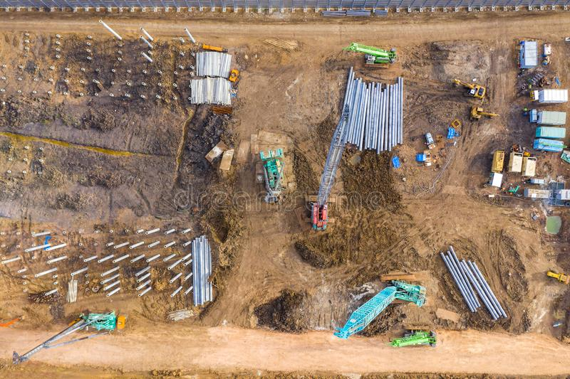 Aerial drone view of excavator loading the tipper truck at the construction site royalty free stock image