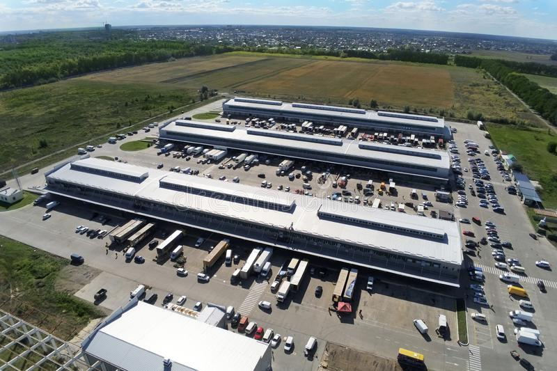 Aerial drone view of group of large modern industrial warehouse or factory buildings in suburban city area.Logistic. Transportation cargo terminal royalty free stock photography