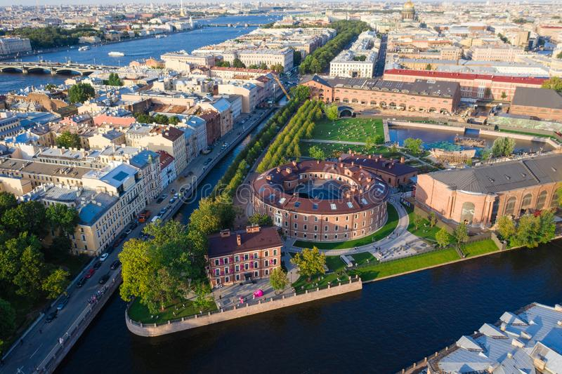 Aerial drone view of historical city part with old architecture and modern park between two artificial river channel, round royalty free stock photography