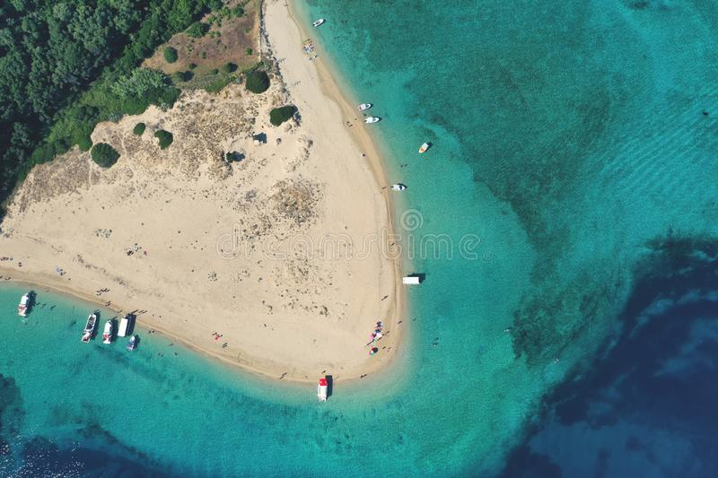 Aerial drone view of iconic small uninhabited island of Marathonisi featuring clear water sandy shore and natural hatchery of royalty free stock images