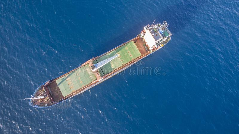 Aerial drone view of an isolated cargo ship.  royalty free stock photo