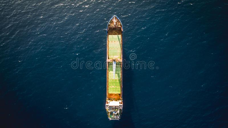 Aerial drone view of an isolated cargo ship. Greece royalty free stock images