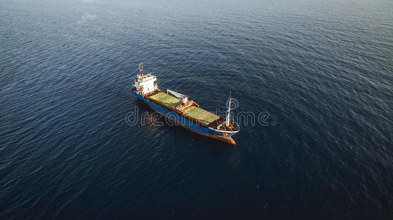 Aerial drone view of an isolated cargo ship. Greece stock image
