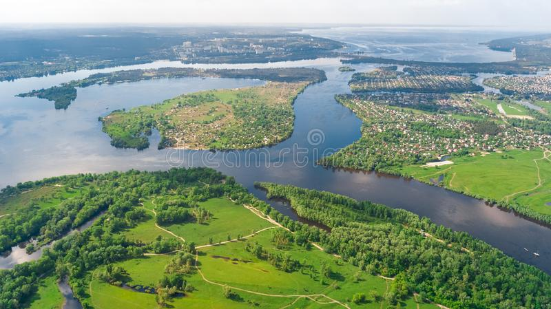 Aerial drone view of Kyiv cityscape, Dnieper and Dniester river, green island from above, Kiev city skyline and parks, Ukraine. Aerial drone view of Kyiv stock photo