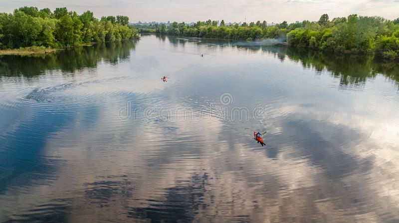 Aerial drone view of Kyiv cityscape, Dnieper and Dniester river, green island from above, Kiev city skyline and parks, Ukraine. Aerial drone view of Kyiv royalty free stock photo