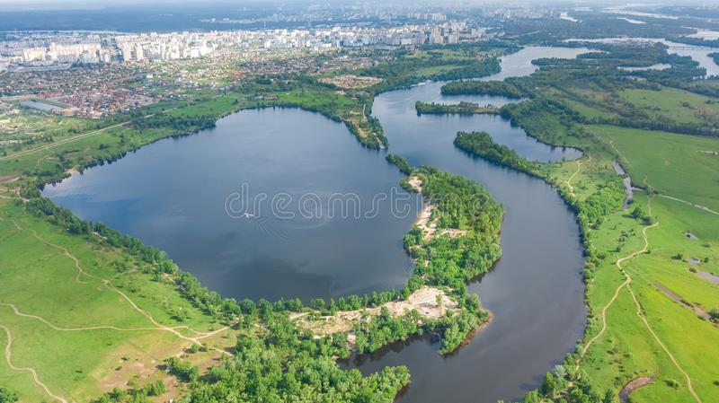 Aerial drone view of Kyiv cityscape, Dnieper and Dniester river, green island from above, Kiev city skyline and parks, Ukraine. Aerial drone view of Kyiv royalty free stock images
