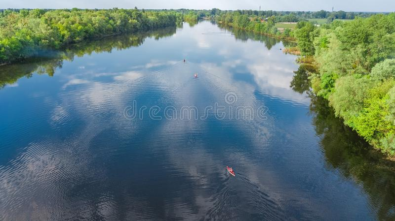 Aerial drone view of Kyiv cityscape, Dnieper and Dniester river, green island from above, Kiev city skyline and parks, Ukraine. Aerial drone view of Kyiv stock photos