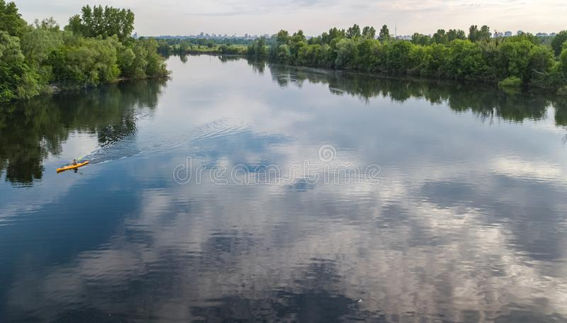 Aerial drone view of Kyiv cityscape, Dnieper and Dniester river, green island from above, Kiev city skyline and parks, Ukraine. Aerial drone view of Kyiv stock image