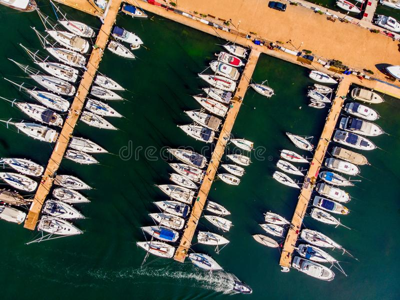 Aerial Drone View of Marina with Sailboats and Motor Boats Docked in Pier. stock photography