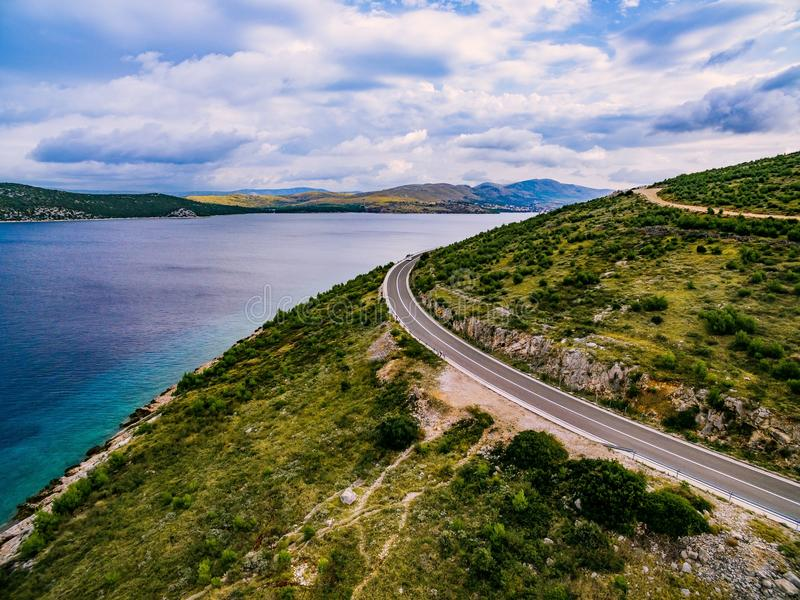 Aerial view of mountain road near the turquoise sea in summer Croatia. stock image