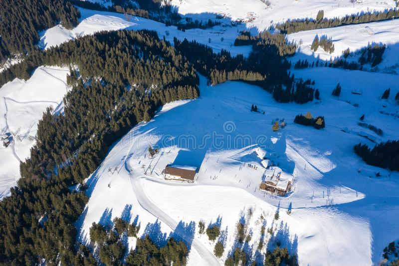 Aerial drone view of mountains,forest and winter ski resort stock photo