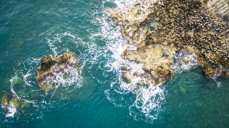 Aerial drone view of the ocean and waves crashing on rocks. Amazing Greece stock photos