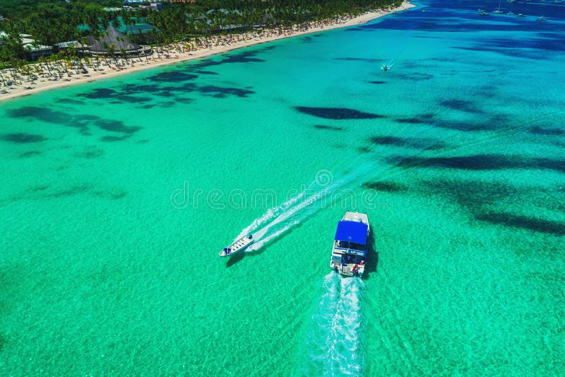 Aerial drone view over the seascape, catamaran boats in the Caribbean sea. Beach resort Punta Cana, Dominican Republic. Summer royalty free stock image