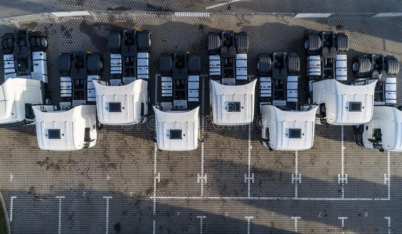 Aerial drone view of parked white trucks. Road transport royalty free stock photo