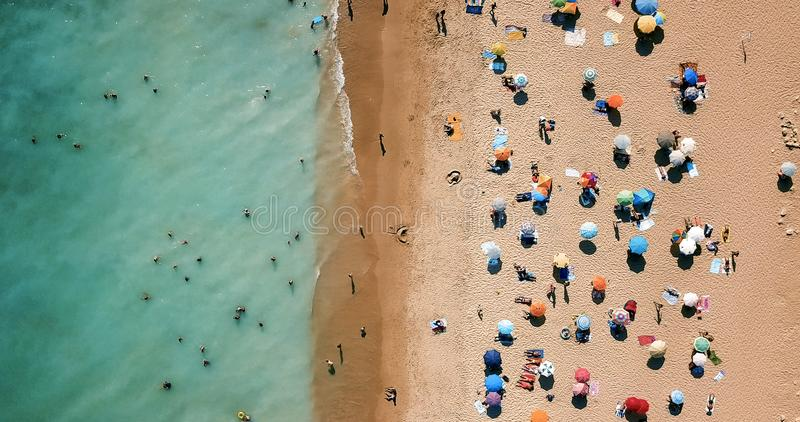 Aerial Drone View Of People On Beach In Portugal royalty free stock photos