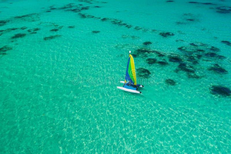 Aerial drone view of sailing sailboat surf or catamaran in turquoise water of Caribbean sea near Punta Cana beach stock photos