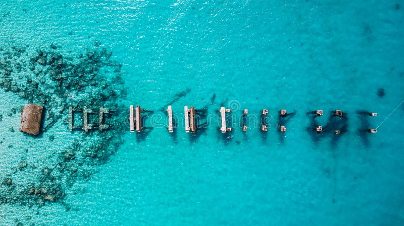 Aerial drone view of Saona Island in Punta Cana, Dominican Republic. With reef, trees and beach in a tropical landscape with boats and vegetation royalty free stock photo