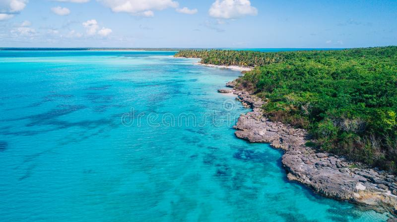 Aerial drone view of Saona Island in Punta Cana, Dominican Republic. With reef, trees and beach in a tropical landscape with boats and vegetation royalty free stock photography