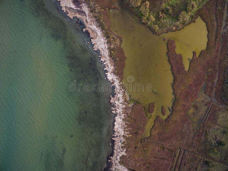 Aerial drone view of the sea and marsh land. .Amazing Greece stock image