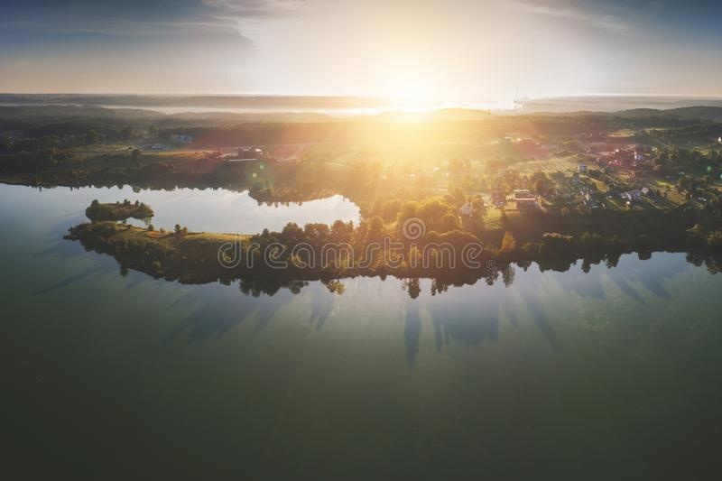 Aerial Europe scenic landscape of big lake. High quality sunrise aerial Europe scenic landscape of big lake and tree shadows, dawn time royalty free stock photography