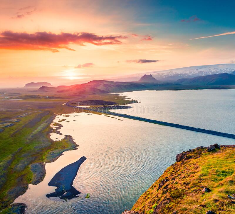 Aerial evening view from the Dyrholaey peninsula, Atlantic ocean. Summer sunset in South Iceland, Vic village location, Europe. Beauty of nature concept stock photos