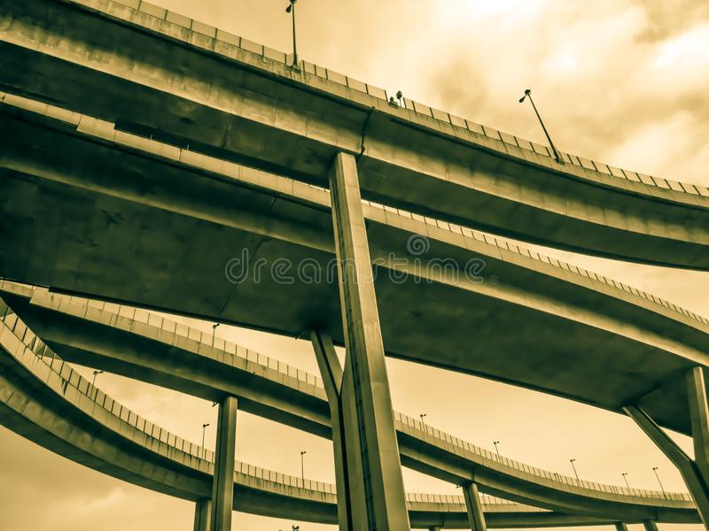 Aerial express way and bypass road symbol of modernity, futuristic urban background. Aerial express way and bypass road, sky train overpass, suspension bridge royalty free stock images