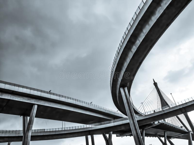 Aerial express way and bypass road symbol of modernity, futuristic urban background. Aerial express way and bypass road, sky train overpass, suspension bridge royalty free stock photography