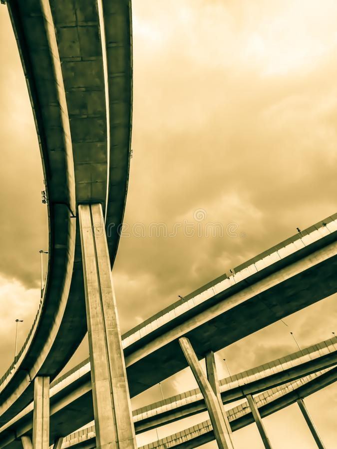 Aerial express way and bypass road symbol of modernity, futuristic urban background. Aerial express way and bypass road, sky train overpass, suspension bridge royalty free stock image