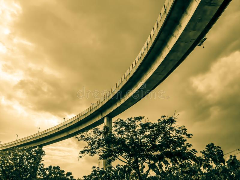 Aerial express way and bypass road symbol of modernity, futuristic urban background. Aerial express way and bypass road, sky train overpass, suspension bridge stock photo