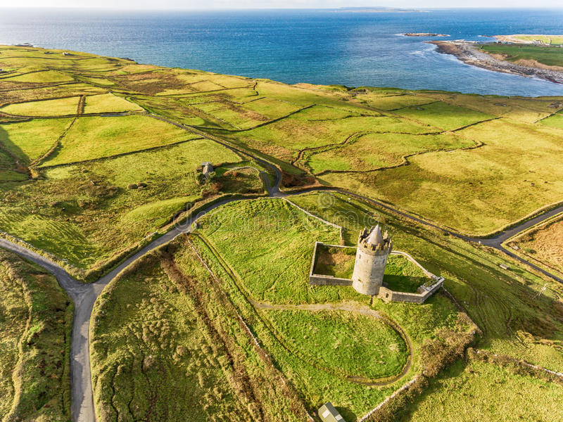 Aerial Famous Irish Tourist Attraction In Doolin, County Clare, Ireland. Doonagore Castle is a round 16th-century tower Castle. Aran Islands and along The Wild royalty free stock images