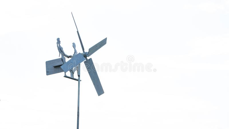 Aerial fan pole with a male and female figure. On a white background stock photos