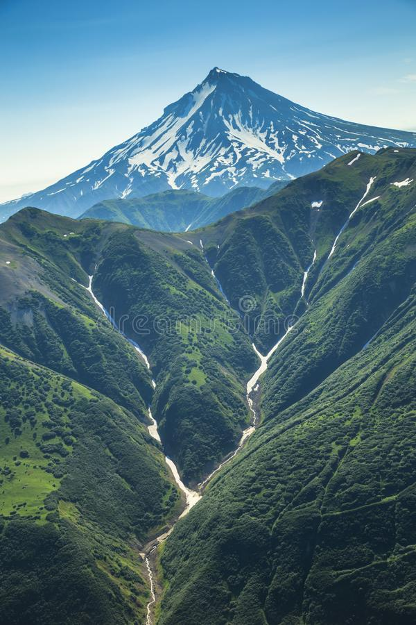 Aerial flight breathtaking view of Kamchatka the land of volcanos and green valleys stock photo
