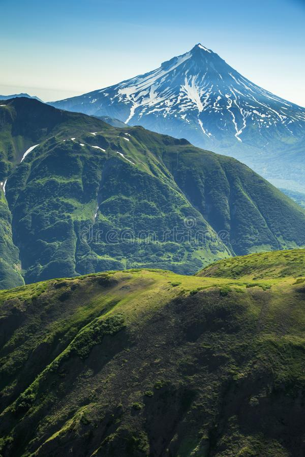 Aerial flight with view of Kamchatka the land of volcanos and green valleys royalty free stock photography