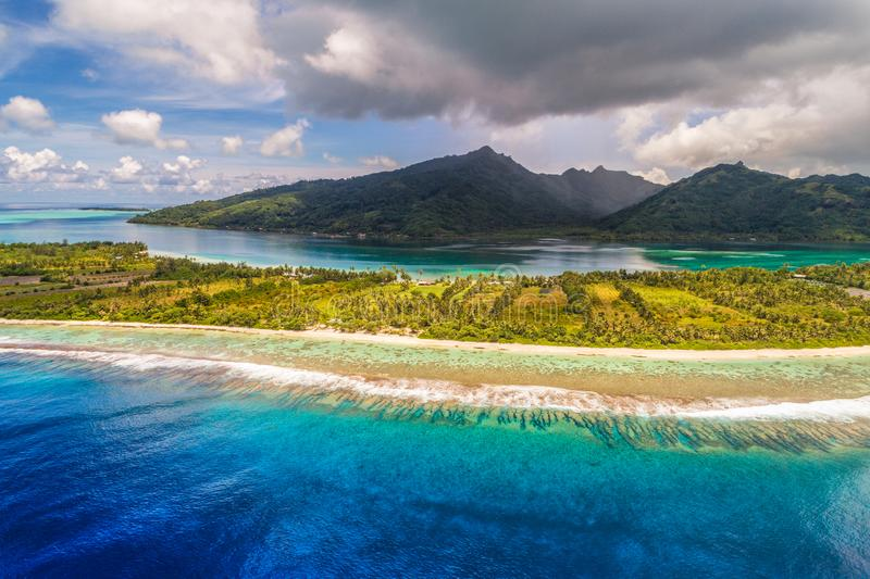 Aerial French Polynesia luxury travel honeymoon destination. Beach vacation at motu island of Huahine, Tahiti, Oceania adventure. royalty free stock image