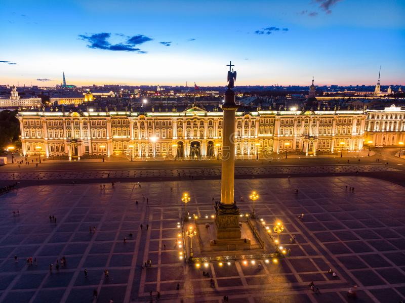 Aerial front view at the Winter Palace building in white nights, exterior Palace Square and Aleksandr Column at summer. Top view. Aerial front view at the Winter stock image