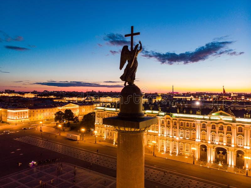 Aerial front view at the Winter Palace building in white nights, exterior Palace Square and Aleksandr Column at summer. Top view. Aerial front view at the Winter stock photography