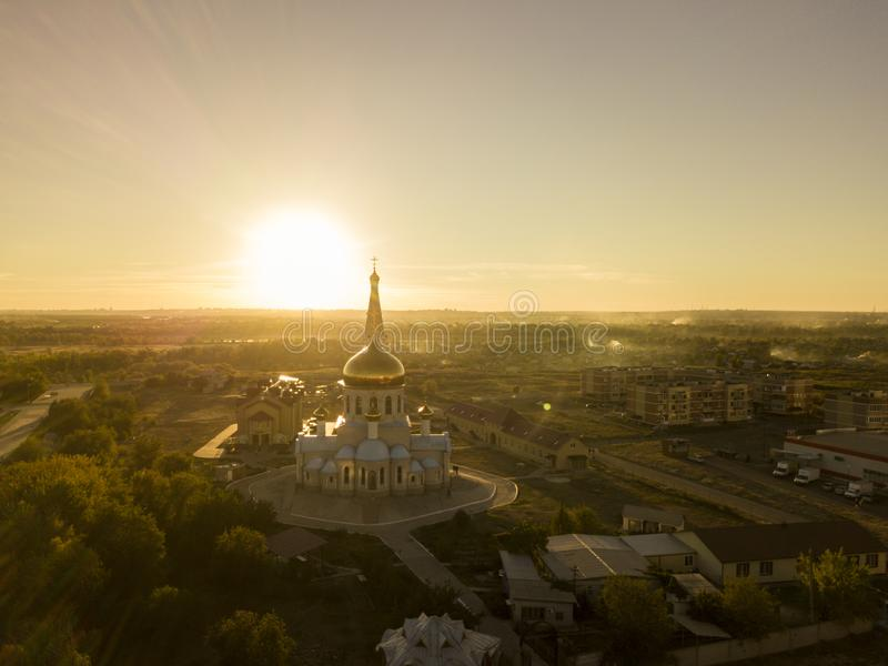 Aerial gorgeous gold and white church during the sunset against the amazing skyline d royalty free stock photo