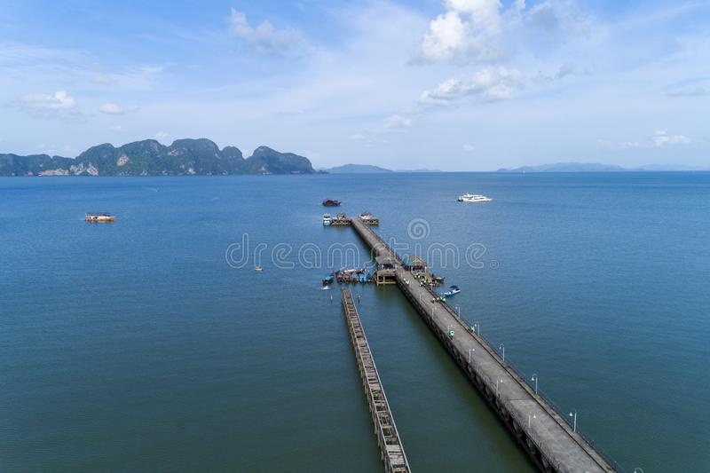 Aerial high angle view drone shot of pier with long tail boats fisherman in summer season beautiful landscape view image from. Drone royalty free stock photography