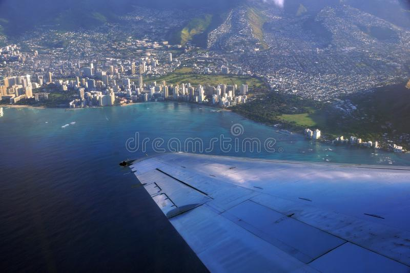 Aerial high in the sky shot of window view of plane leaving Honolulu, Hawaii royalty free stock photo
