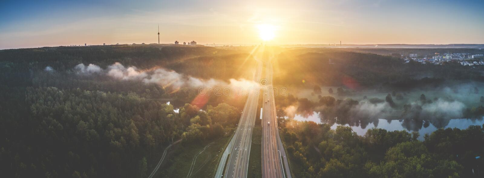 Aerial highway road at sunrise near river royalty free stock photo