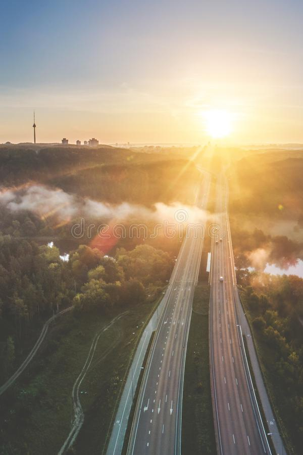 Aerial highway road at sunrise near river royalty free stock photos