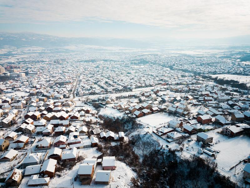 Aerial of rooftops covered with snow royalty free stock photo