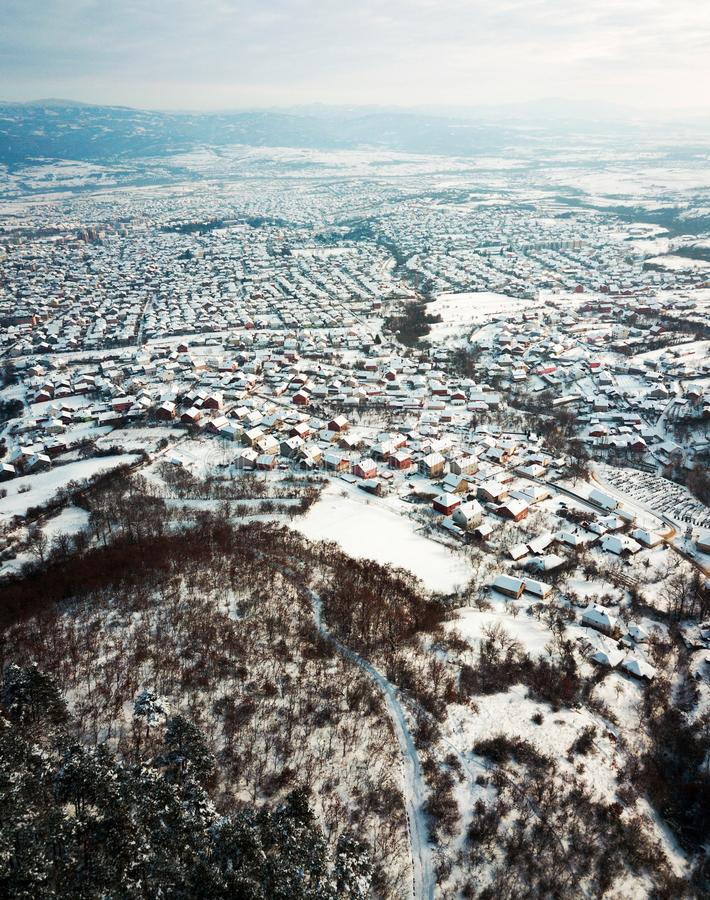 Aerial of rooftops covered with snow stock photos